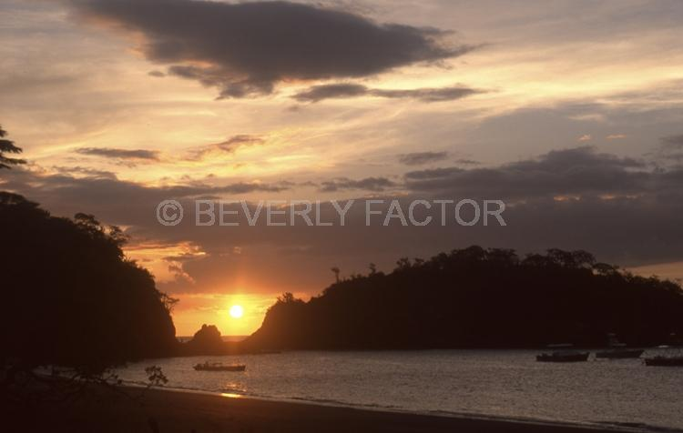Sunset;colorful;sky;el ocdtal costa rio;cloudsl sun;yellow;water;boat;sillouettes;anchorages;ocean