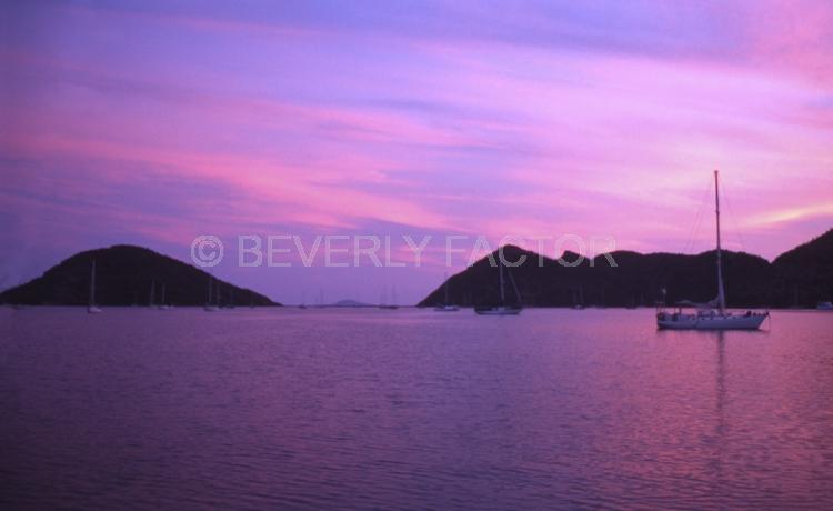 Island;Sunset;sky;sun;water;red;sillouettes;ocean;boats;purple;sea of cortez