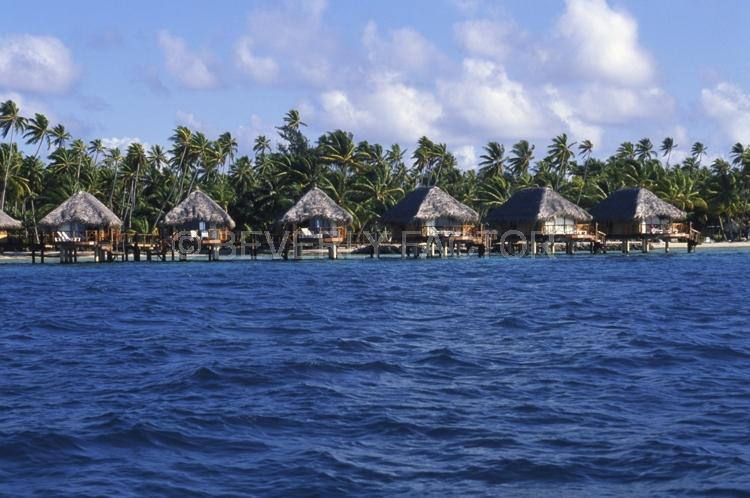 Islands;huts;ocean;palm trees;blue;water;sky;manihi;french polynesia